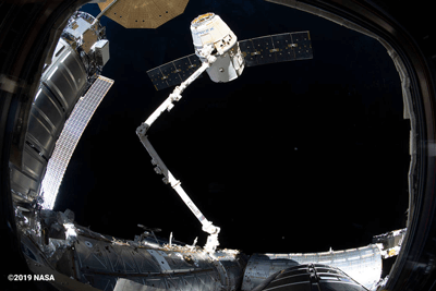 SpaceX's Cargo Dragon 17th resupply mission to the ISS on the Canadarm2.